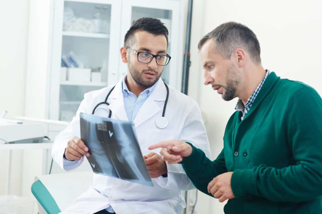 doctor and patient looking at x-ray result