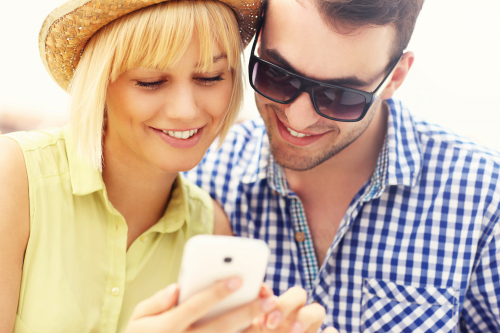 Couple looking at cellphone
